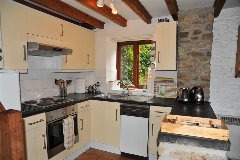 Photograph of 146-3-well equipped kitchen