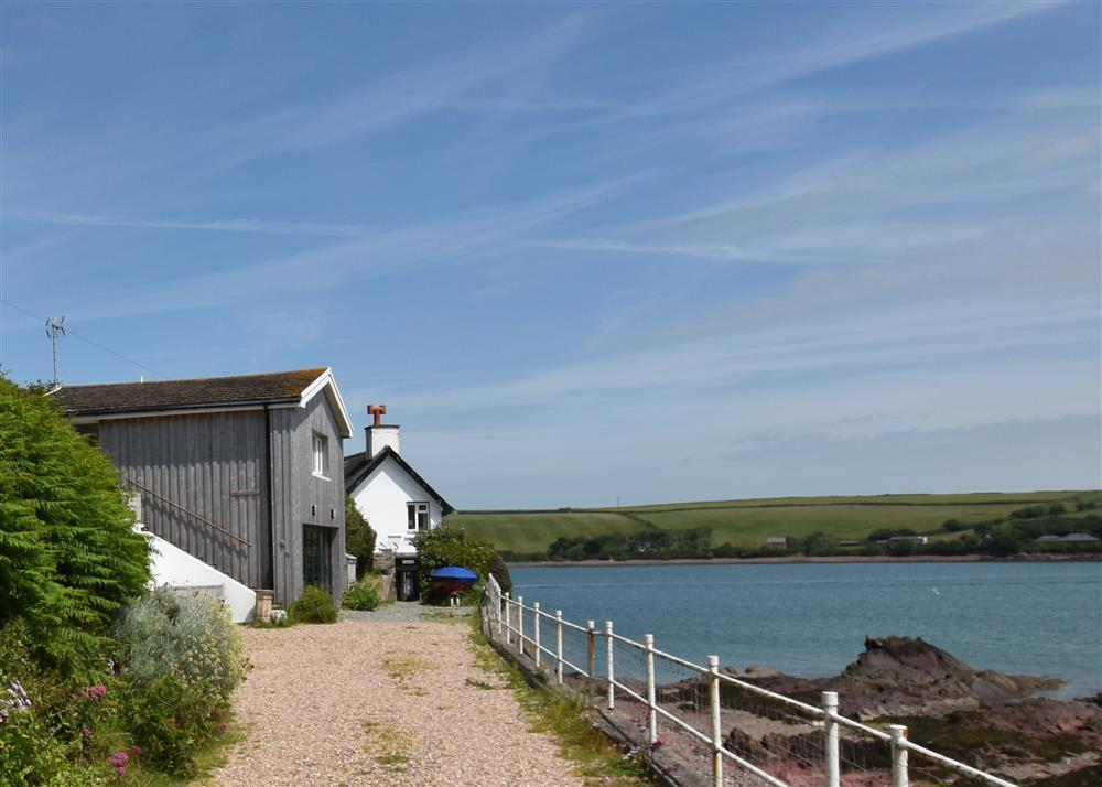 Seafront boathouse accommodation on the waterfront at Dale beach  Sleeps: 2  Property Ref: 557