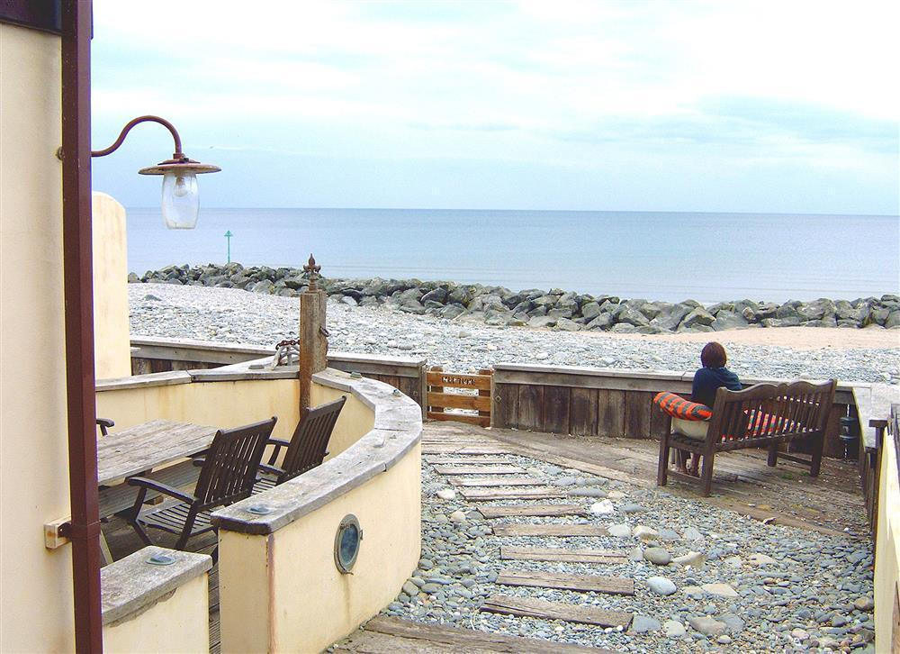 Quirky 1940's style holiday house practically on Borth beach  Sleeps: 7  Property Ref: 577
