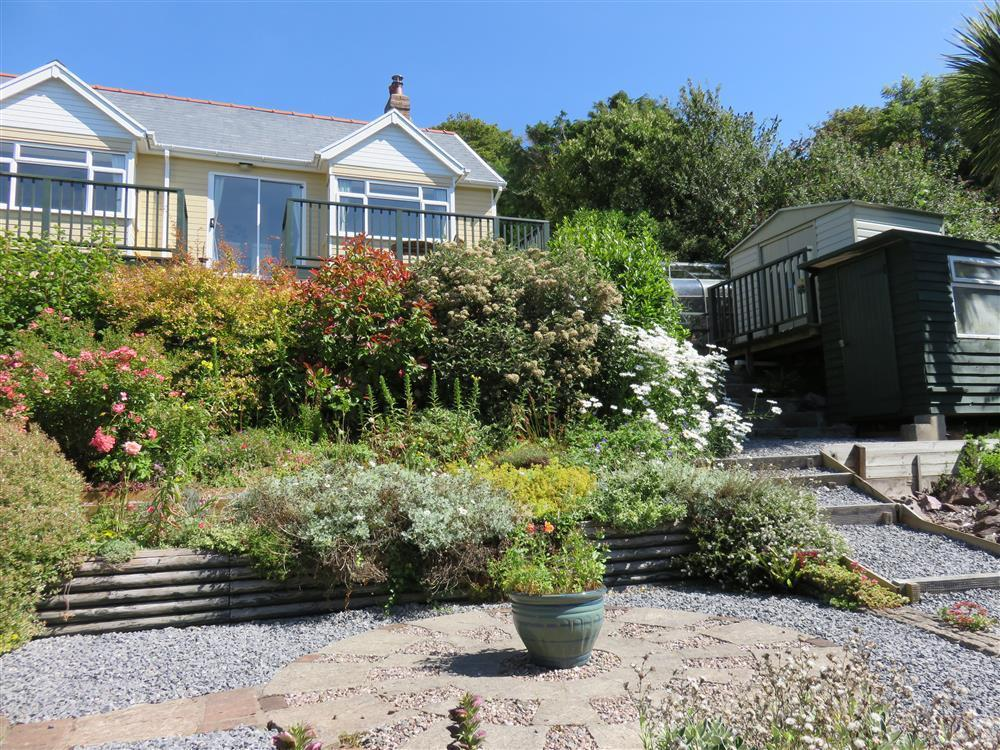 Detached holiday bungalow in almost an acre of lovely terraced gardens - Sleeps 4 - Ref 2083
